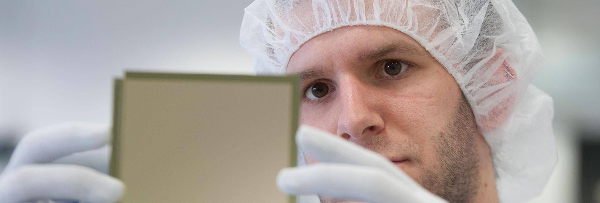 Man holding an OLED lighting panel