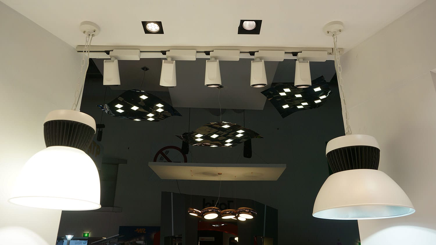 Three pendant OLED luminaires Pixelate hanging from a ceiling