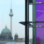 Detail of OLED luminaire and the television tower of Berlin in the background