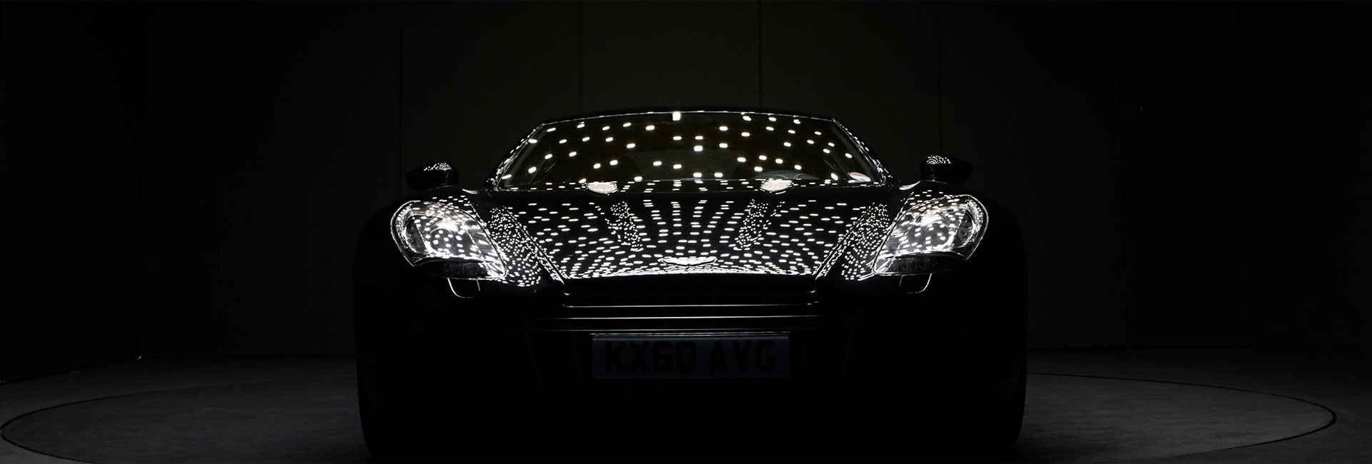 OLEDs reflecting in the car body of Aston Martin One-77