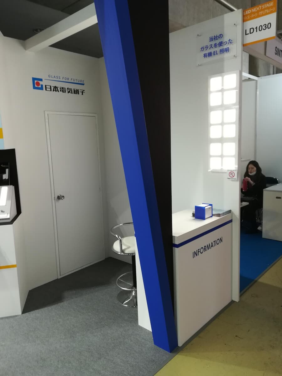 Nippon Electric Glass booth showing OLEDWorks OLED lighting panels at LED NEXT STAGE