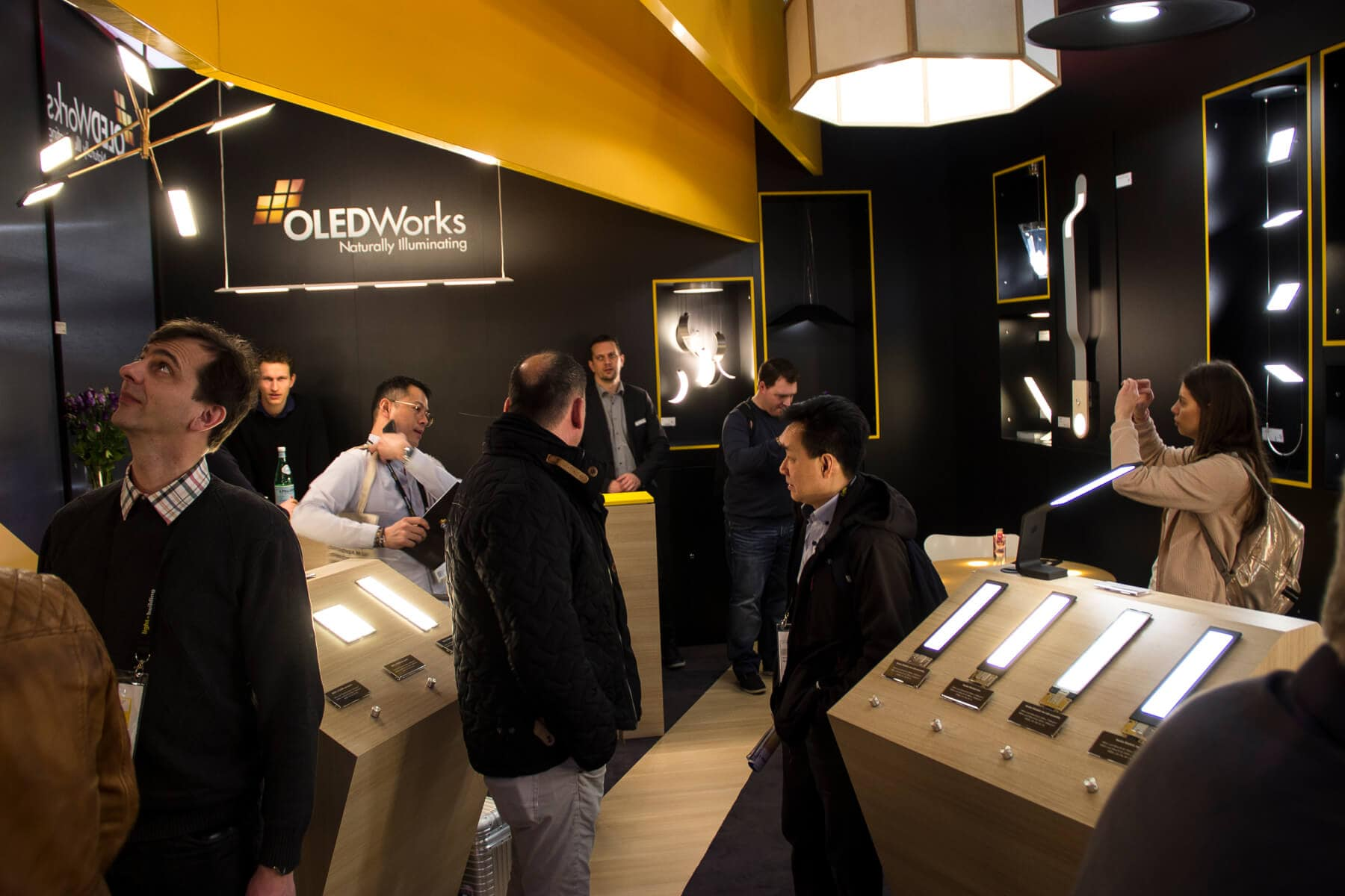crowded OLEDWorks booth at Light + Building 2018