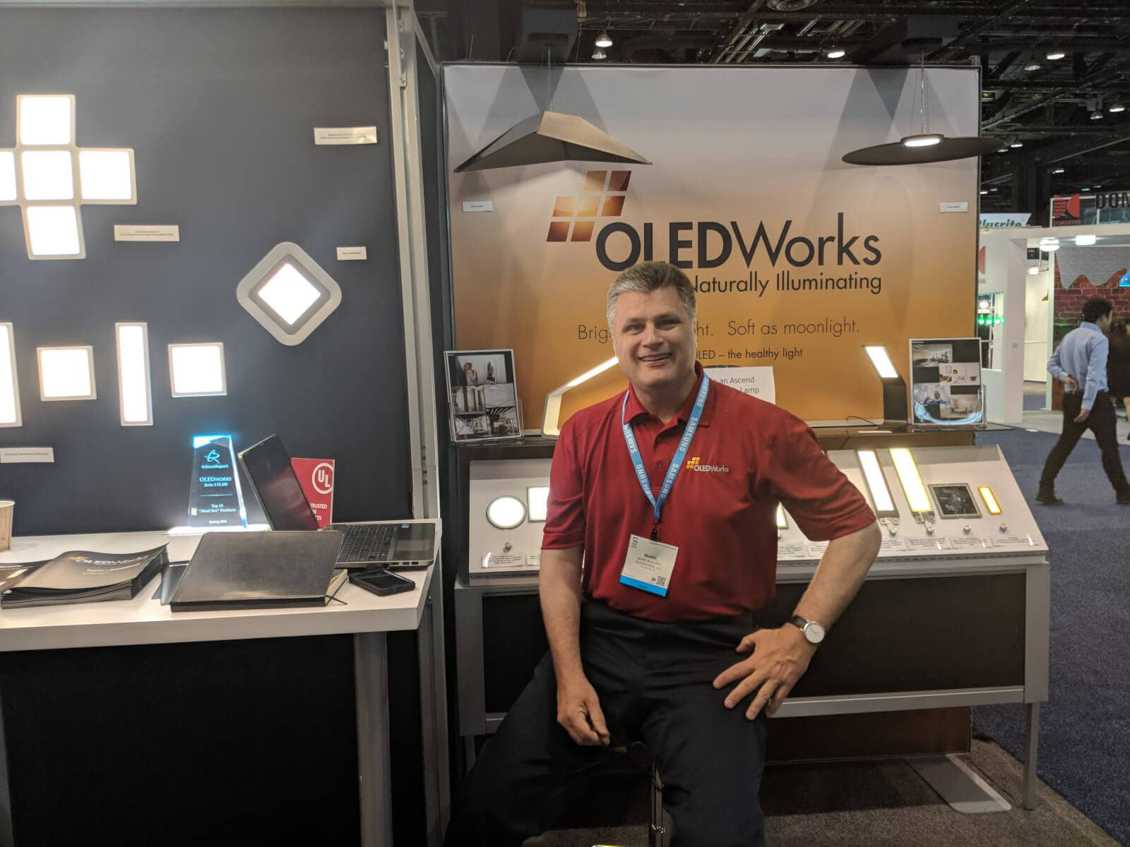 National Accounts Manager Mark McElroy at OLEDWorks booth at Lightfair 2018