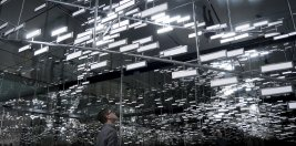 Man looks at OLED lighting installation Light Cloud