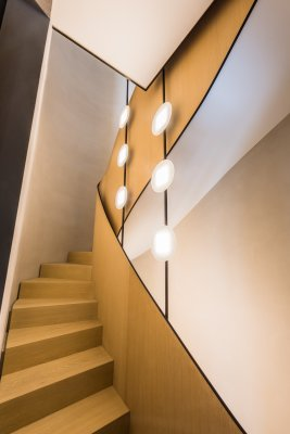 Two OLED light fixtures in the stairwell of a private residential building