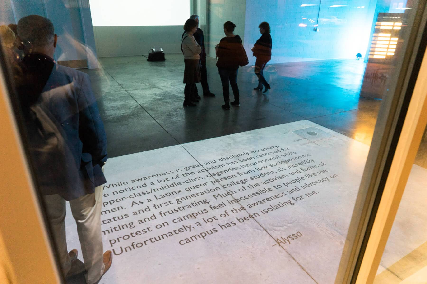 A survivor statement that is projected on the floor of the Broad Art Lab in downtown East Lansing