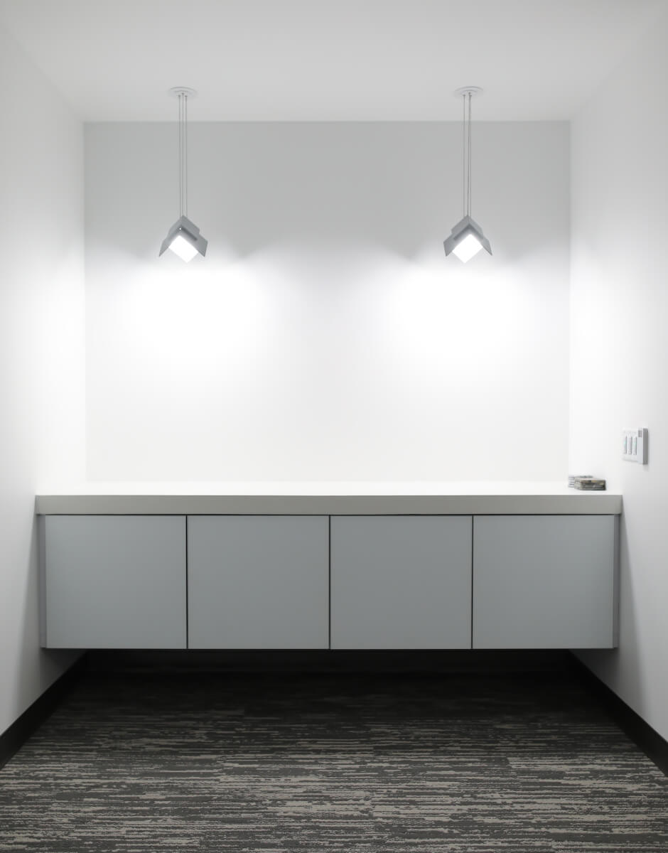 Visa Lighting's OLED pendant luminaire Petal in the conference room nook at QCI