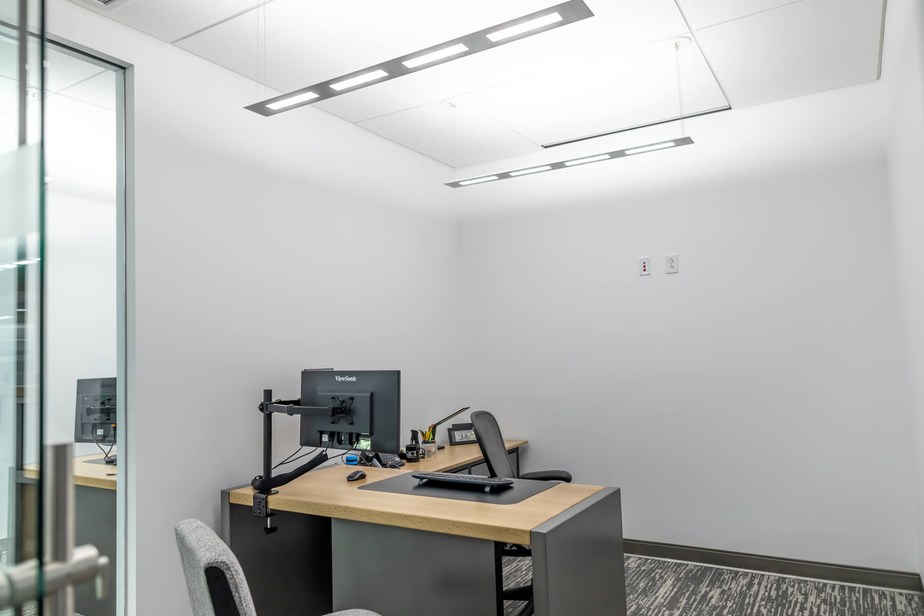 OLED pendant luminaire Olessence Slim from Acuity Brands in office of QCI
