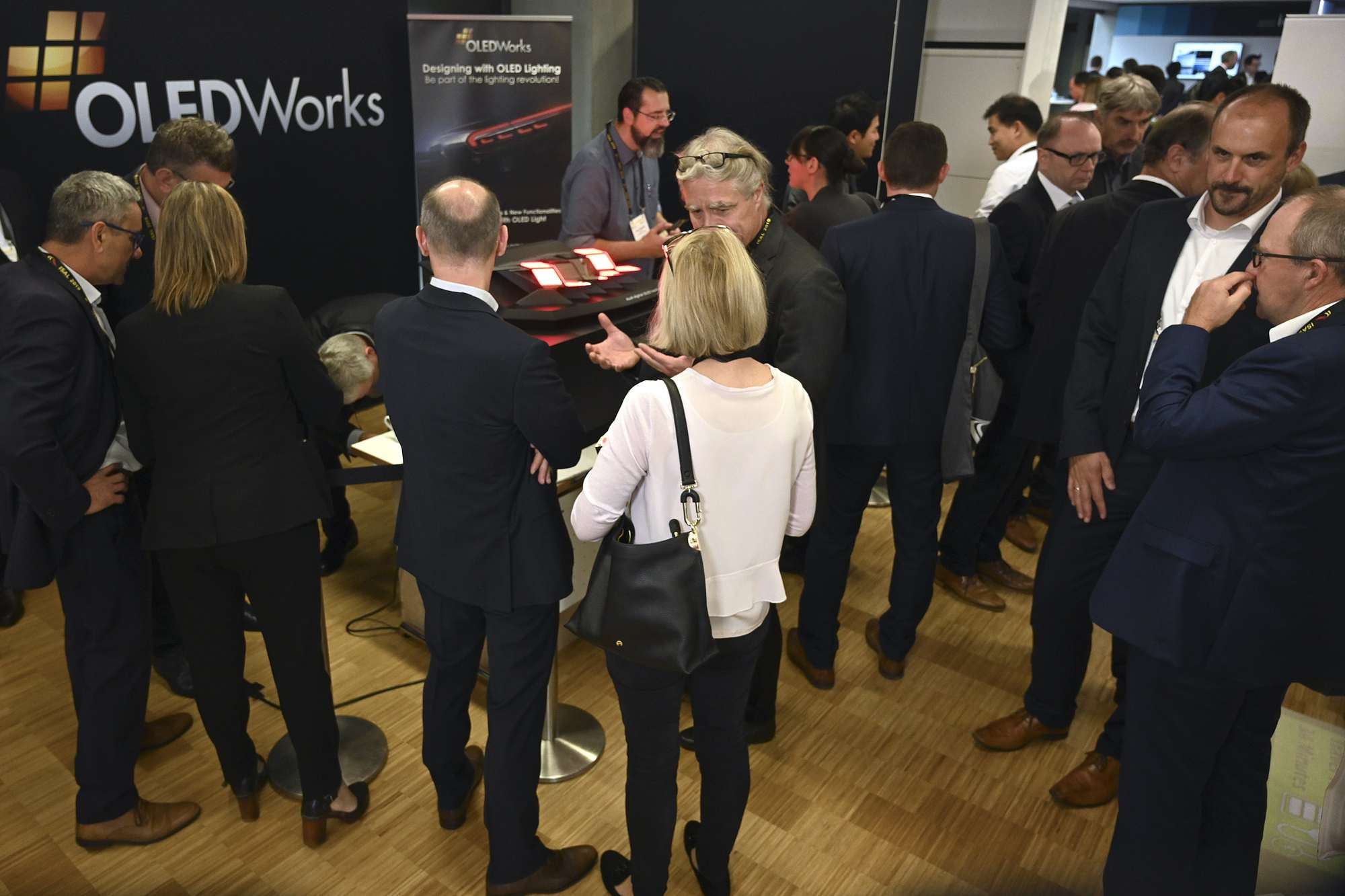 Crowded booth at ISAL 2019 | OLEDWorks