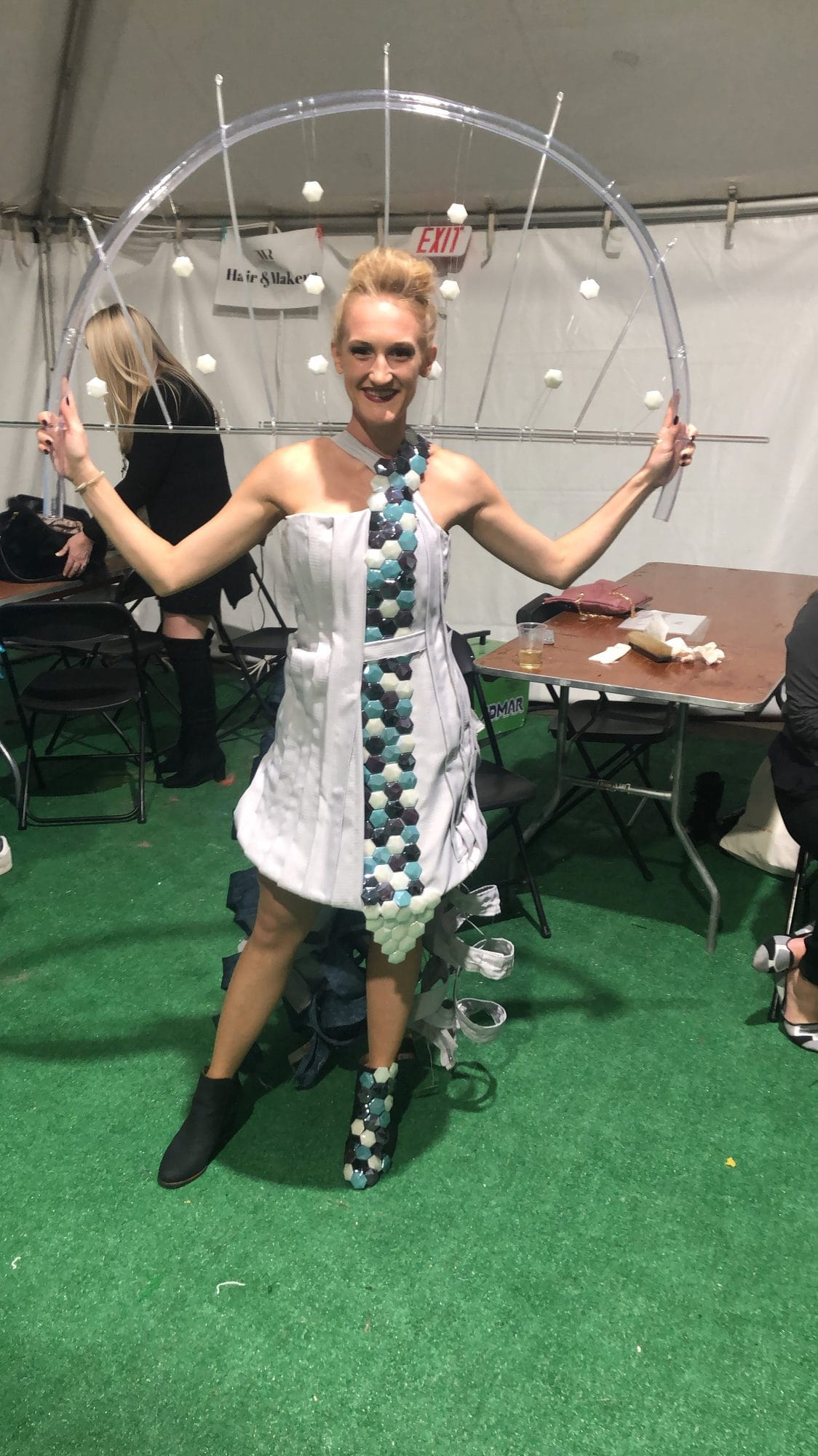 Model wearing Hunt dress with OLEDWorks panels at Runway to Rochester, 2019 | OLEDWorks